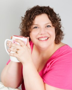 Carla Anne Coroy Author Speaker Mentor photo pink shirt with coffee