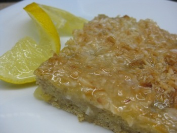 Gluten Free Tropical Cake Squares - Carla Anne Coroy - square of gluten free fruit punch cake garnished with lemon