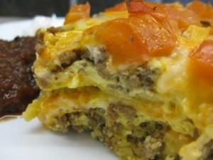 Breakfast Lasagna - Carla Anne Coroy - serving portion of breakfast lasagna corn tortilla casserole