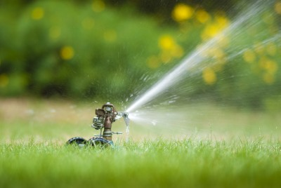 Sprinklers - Carla Anne Coroy - A water sprinkler on grass