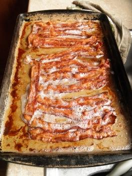 Baking Bacon - Carla Anne Coroy - strips of bacon in a baking pan